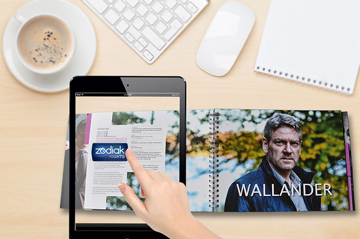 Pointing an iPad at static images in the catalogue triggers promotional videos