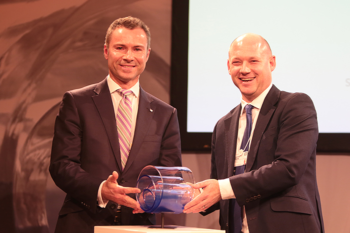 David Bateson, Senior Vice President of Legal, IP and Sustainability at Canon Europe, receives The Circulars award trophy from Andy Wales, Corporate Affairs Director, SAB Miller