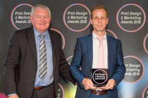 (l to r) Terry Garvey, Sales Director sponsor EFI, presents the award to MX Display's David Lister