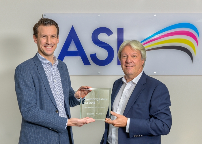 Matt McLoughlin from Grant Thornton presenting top 100 Cambridgeshire company award to ASL Chief Executive Mark Garius
