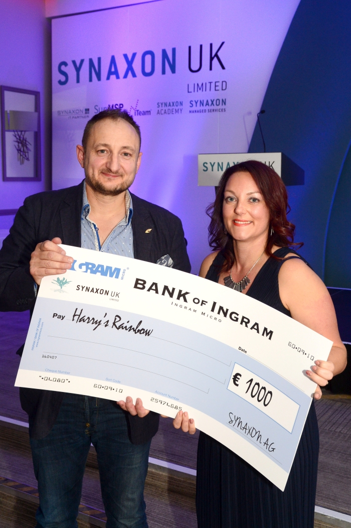 Odette Mould, CEO and Family Liason Officer at Harry's Rainbow, receiving a cheque from Mike Barron, Channel Director of Synaxon UK
