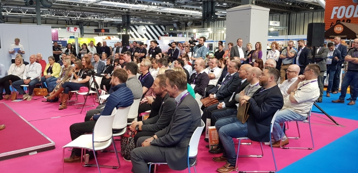 Visitors gather to take part in a Q&A sessions with Sir Ranulph Fiennes OBE on the opening day of The Print Show 2019